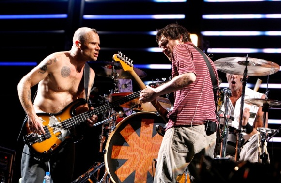 """INDIO, CA - APRIL 28:  Musicians Flea (L) and John Frusciante from the band """"Red Hot Chili Peppers"""" perform during day 2 of the Coachella Music Festival held at the Empire Polo Field on April 28, 2007 in Indio, California.  (Photo by Kevin Winter/Getty Images) *** Local Caption *** Flea;John Frusciante"""