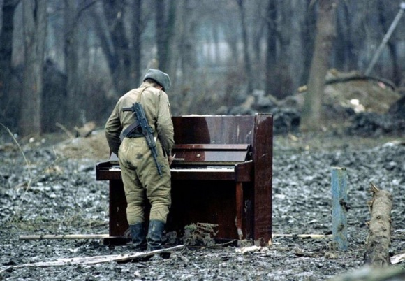 russian-soldier-playing-an-abandoned-piano